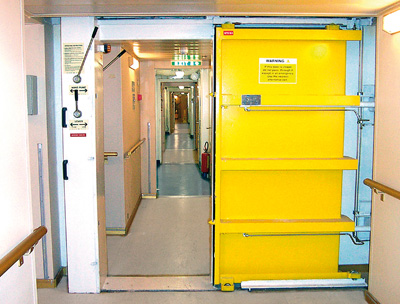 A hydraulically-operated watertight door with an opening of 2000 mm height and 900 mm width mounted in a corridor to crew cabins one to two decks below the ... & The dangers of power-operated watertight doors - GARD